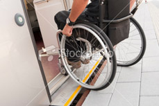 Male wheelchair user boarding the tube. Transitional Rehabilitation, moving back into the community.