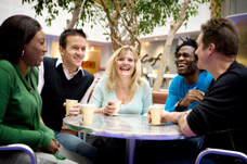 Group of friends chatting in cafe. Neurological Rehabilitation Services in South London.