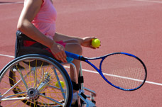 Male wheelchair user playing tennis. Neurorehabilitation treatment and programmes to help with activities.