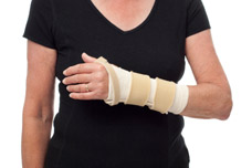 Female wearing wrist splint. Splinting Therapy to help with tissues and ligament problems.