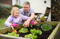 Male gardening with daughter - Neuro rehab engagement activities.